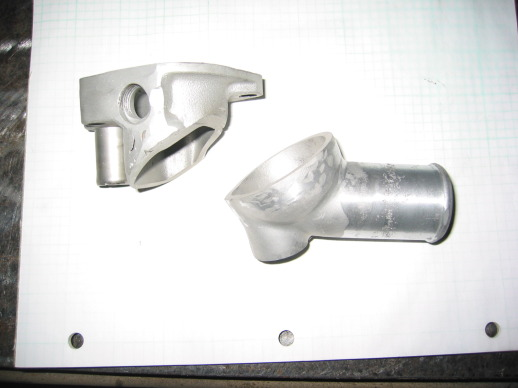Pieces from Ford and Mazda thermostat housings