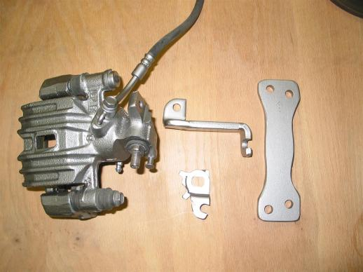 Rear brake caliper with adapter parts